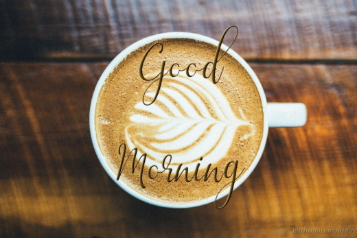 Good Morning Wish on Beautiful Cream Leave on Coffee in Cup Table